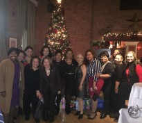 100HWW President, Meiling Macias-Toro, 100 Hispanic Women Nat'l Chapter President, Nancy Genova, posing with Board members and Guests at the Toy Drive